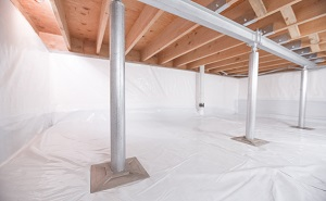 Crawl space structural support jacks installed in Howard Beach