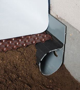 Closeup of a crawl space drainage system installed in Middle Village
