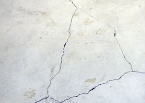 cracks in a slab floor consistent with slab heave in Fresh Meadows.