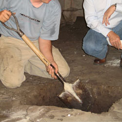 Digging a hole for the engineered fill used in a crawl space support system installation in Astoria