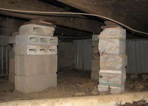 crawl space repairs done with concrete cinder blocks and wood shims in a Fresh Meadows home
