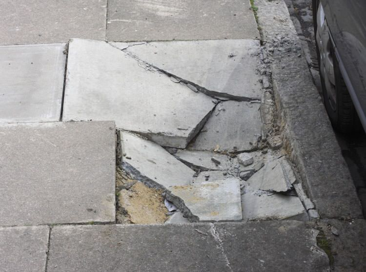 Photo Of A Sinking Concrete Sidewalk With S In Saint Albans