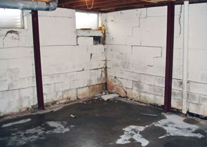 A failed, rusty i-beam foundation wall system installed in Middle Village.