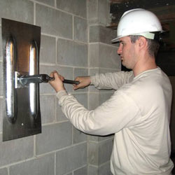 installing a wall anchor to repair an bowing foundation wall in Ridgewood