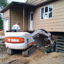Excavating to expose the foundation walls and footings for a replacement job in Woodside