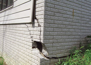A severely damaged foundation wall in Elmhurst