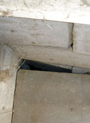 inward rotation of a foundation wall damaged by street creep in a garage in Oakland Gardens