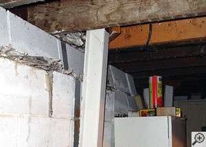 A failing foundation wall and i-beam support in a Brooklyn home