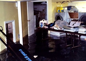 A laundry room flood in Ozone Park, with several feet of water flooded in.