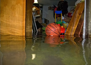 A flooded basement bedroom in Middle Village