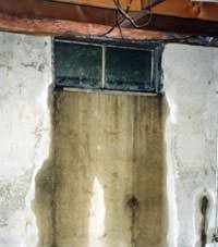 Flooding through basement windows in a Sunnyside home.
