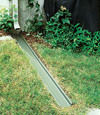 A recessed gutter drain extension installed in Sunnyside, New York