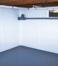 Plastic basement wall panels installed in a Ridgewood, New York home